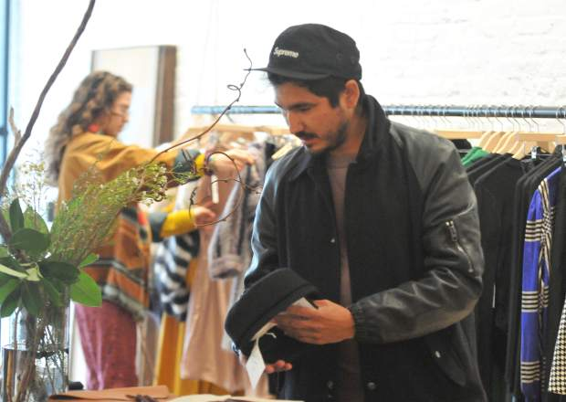 Lucas MacAuley looks at a hat for sale at Luxe Nomad in downtown Nevada City Thursday afternoon. While the store emphasizes in women's apparel, owners are considering adding a section for men's clothing as well.