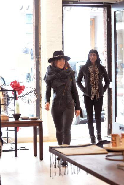 Potential customers enter the Luxe Nomad store following Thursday's ribbon cutting.