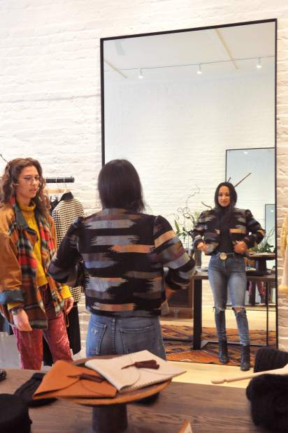 Nevada County local Isis Indriya tries on an article of clothing with the help of Grass Valley's Alejandra Falcon inside of the new Luxe Nomad clothing store on Nevada City's Broad Street.