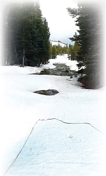 For most of the past 90 winters, snowpack within the watersheds managed by Nevada Irrigation District has held a frozen reservoir of water — about enough to supply local customers for a year. The photo on the left shows the English Mountain area, at the center of NID's snowpack formation region 28 miles northeast of Nevada City, in 2016 — a year of near-average snowpack. The photo on the right shows the English Mountain area in 2015, a year of historic low snowpack.