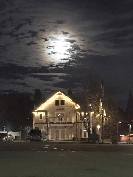 Super moon in the clouds the night of New Year's Day at Neal and South Auburn streets in Grass Valley