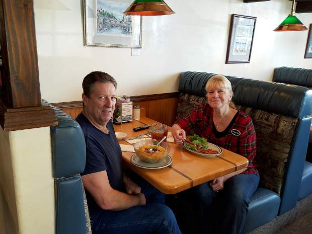 John and Paulette Rickard, owners of Paulette's Country Kitchen, enjoying their own food in a rare lunch break together.