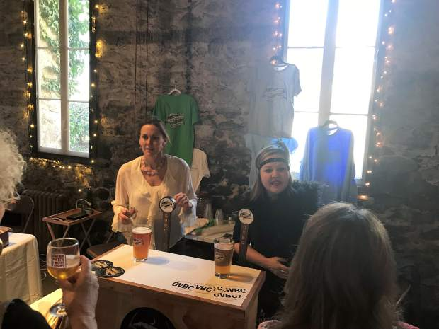 Carah Rogers and Heidi Wingo of Grass Valley Brewing Co. serving beer to attendees of Sunday's Chocolate Infusion event at the Miner's Foundry.
