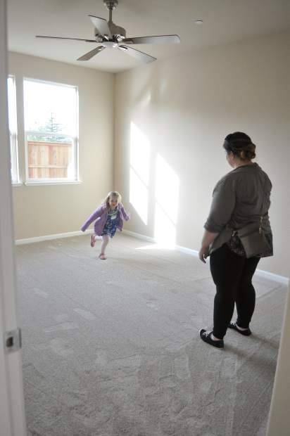 Ashley Harris and daughter Julia, walk through one of the recently finished homes off of Oliver Lane in Grass Valley.