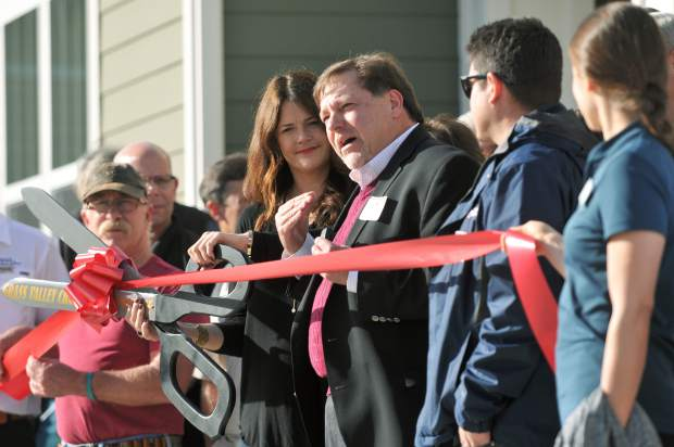 Towne Homes executives from Sacramento take part in the ceremonial ribbon cutting ceremony Tuesday afternoon in Grass Valley.