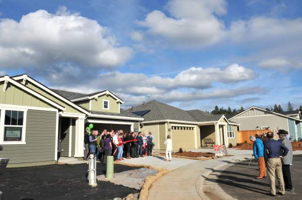 Home builders take part in the ceremonial ribbon cutting ceremony Tuesday at Ridge Meadows in Grass Valley.
