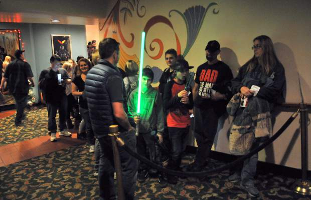 Folks wait in line in the Del Oro Theater for the advanced showings of the latest Star Wars movie.