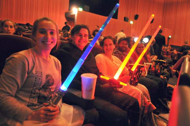 The Hedenlund family poses with their light sabers as they await the 7 o'clock showing of Star Wars Episode VIII The Last Jedi.