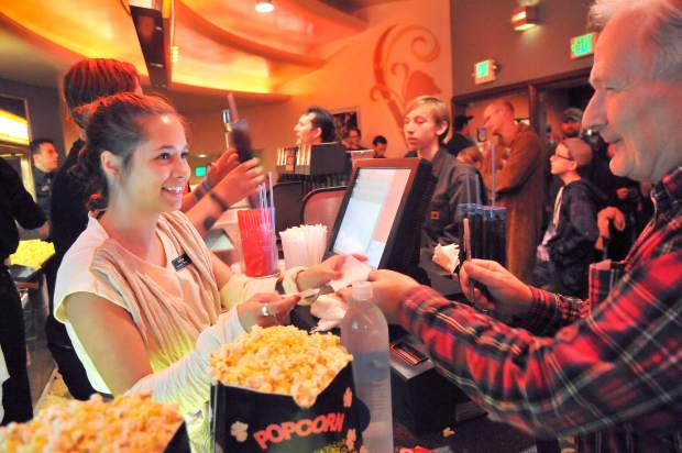 Del Oro Theater concessions employee Ashlyn Yokam dresses the part of a Star Wars Jedi while serving folks ready to see the first screening's of Star Wars Episode VIII The Last Jedi Thursday night in downtown Grass Valley.
