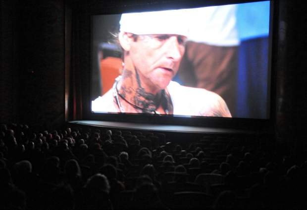 Folsom Prison inmate Rick Misener appears on the big screen of the Del Oro Theater during Thursday evening's one-time showing of
