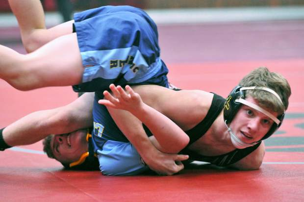 Bear River's Josh Miller, wrestling in the 126 pound bracket, pins his Center High School opponent during Wednesday's double dual meet.