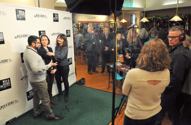 Elisa Parker, of See Jane Do, interviews Karola Aparico and Jeanne Muller during the kickoff event for the Wild and Scenic Film Festival Friday night at Nevada City Winery. Aparico and Muller represent filmmaker Avi Lewis'