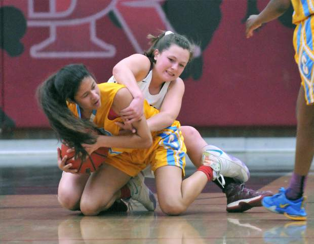 Bear River's Kayla Toft gets scrappy to try to secure a loose ball during Tuesday's league win over the Center High School Cougars.