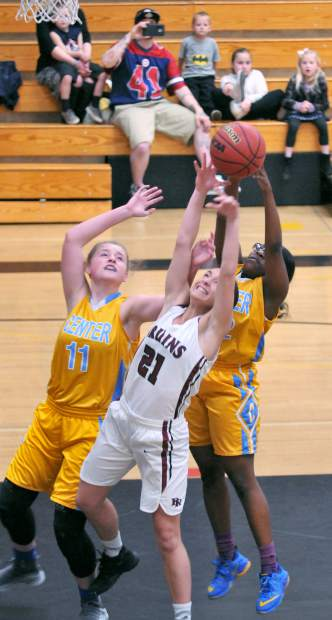 Bear River senior Katelyn Meylor tries to get a shot off under heavy defense from the Center Cougars early during the lady Bruins' PVL league win at home Tuesday.