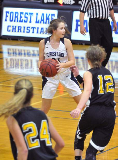 Forest Lake Christian freshman Ellie Wood, brings the ball down the court for the Falcons during their win over Delta earlier this week.