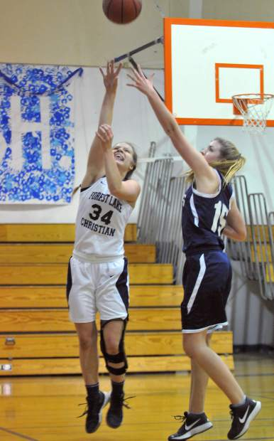 Forest Lake Christian's Johnna Dreschler puts up 2 of her 18 points from the night against the visiting El Dorado Adventist Eagles.