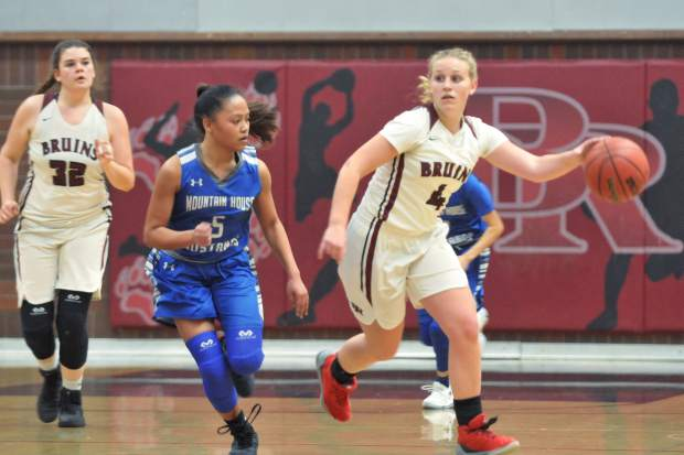 Bear River's Kylee Dresbach-Hill (4) looks for an open teammate as she drives the ball up the court for the Bruins during their win over the Mountain House Mustangs.