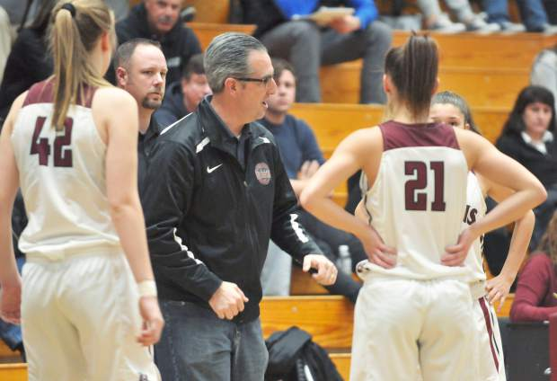 Bear River girls basketball varsity head coach Randy Billingsley talks to his team during a time out.