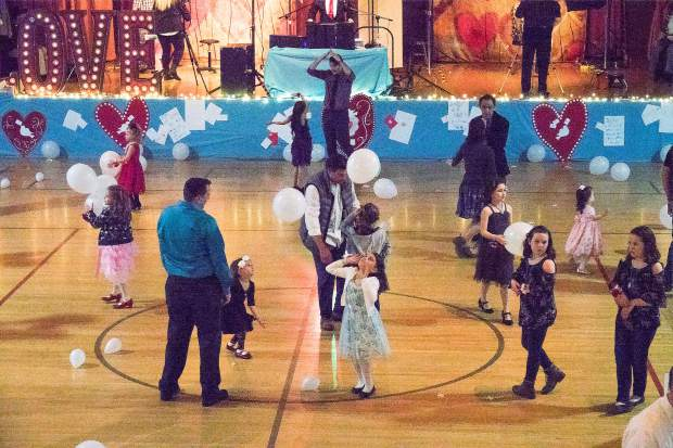 Fathers and daughters dance and play with balloons on the dance floor during Saturday's Daddy Daughter Dance at the Veterans Memorial Building in Grass Valley.