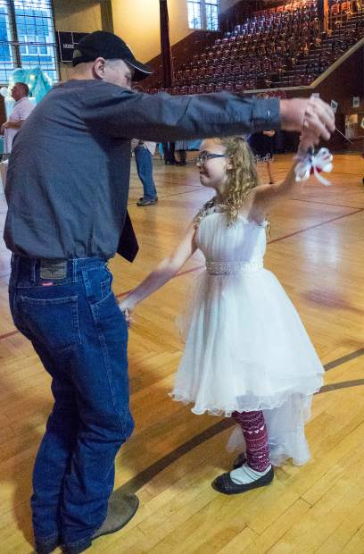 Shaun Rainsbarger and daughter Aleeve, 9, take to the dance floor during Community Beyond Violence's 11th annual Daddy Daughter Dance, Saturday at the Grass Valley Veterans Memorial Building.