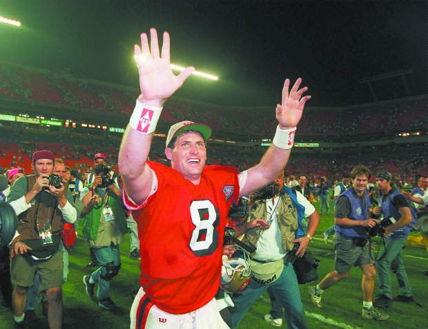 FILE - In this Jan. 29, 1995, file photo, San Francisco 49ers quarterback Steve Young runs a victory lap after his team beat the San Diego Chargers 49-26 in Super Bowl XXIX at Miami's Joe Robbie Stadium. Young was 24 for 36 for 325 yards with no interceptions, and he ran for 49 yards on five carries just for good measure. (AP Photo/Lenny Ignelzi, File)