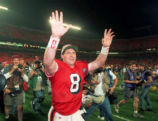 San Francisco 49ers quarterback Steve Young runs a victory lap after his team beat the San Diego Chargers 49-26 in Super Bowl XXIX at Miami's Joe Robbie Stadium. Young was 24 for 36 for 325 yards with no interceptions, and he ran for 49 yards on five carries just for good measure.