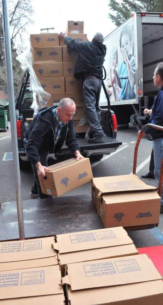 Boxes of Smart Chicken are unloaded from a pallet to be donated to Interfaith Food Ministries Thursday morning in Grass Valley. The donation, an annual event, comes from SPD Market.