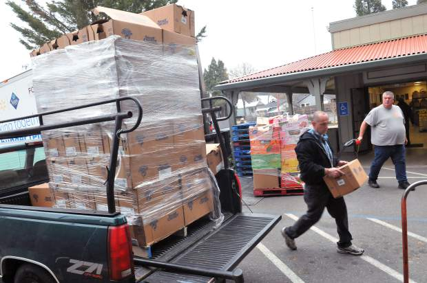 Nevada City SPD Market meat manager Glen Cartwright, helps unload a pallet of chicken that SPD donated to Interfaith Food Ministry Thursday morning off of Henderson Street in Grass Valley. The annual donation is a long standing tradition of support from SPD to the food bank.