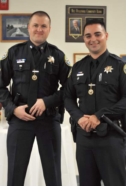Corporal Jesse Cloyd (left) and Officer Mel Bird received medals for their superior life saving efforts during Tuesday's Grass Valley City Council meeting. Bird, a new officer, also had his badge pinned during a ceremony.