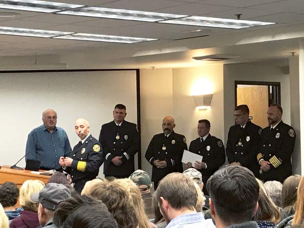 Grass Valley Fire Chief Mark Buttron commended personnel from the Grass Valley and Nevada City police departments for superior efforts in rescuing a victim trapped in a burning building.