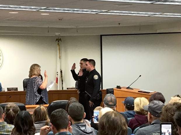 Grass Valley City Clerk Kristi Bashor (left) swears in the city's two newest police officers, Galen Spittler and Mel Bird.