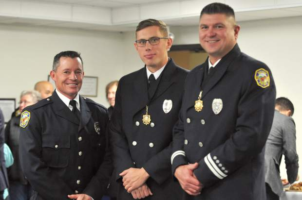 Grass Valley Fire Captain Robert Bundy (from left), Firefighter Kevin Baer, and Engineer Chris Oliver also were awarded medals for their superior life saving efforts. Not pictured are Grass Valley Engineer Will Ray, and Nevada City Firefighter Michael Chau, who also received the award.