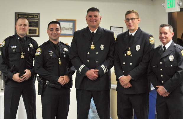 Grass Valley police officers and firefighters received medals for their superior life saving efforts during a call earlier this year. They are (from left) Grass Valley police officers Jesse Cloyd, Mel Bird, Firefighters Robert Bundy, Kevin Baer, Chris Oliver. and not pictured are Will Ray, and Nevada City Firefighter Michael Chau.