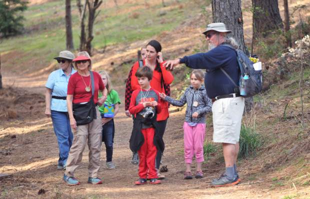 Naturalist, storyteller, and former teacher Steve Roddy points out interesting facts about the plants and animals visible during Saturday's junior conservationist hike along the Litton Trail.