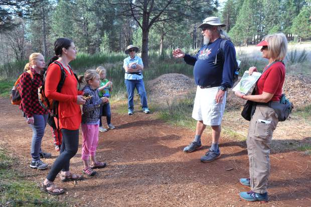 Naturalist, storyteller, and former teacher Steve Roddy paints a picture of how Grass Valley and Nevada City used to be in the days of old during Saturday's junior conservationist hike along the Litton Trail.