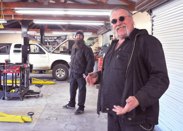 Monte Pearson And Son Archie Stand In The Garage Of Their Auto Shop In  Rough And Ready In Between Working On Vehicles On A Friday Morning.