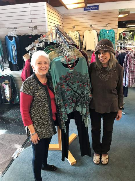 Fresh Image owner, Ruth Ann Riese highlighting an outfit with Linda Morgan at the boutique on Sutton Way.