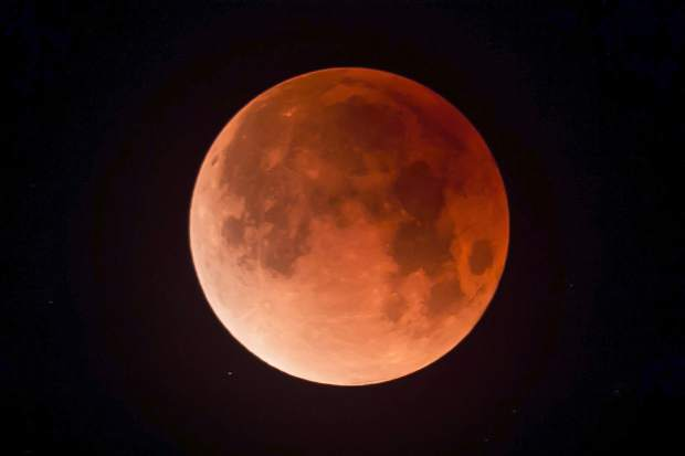 Photo of the lunar eclipse, which also happened to be a blue moon and a super moon, referred to as a