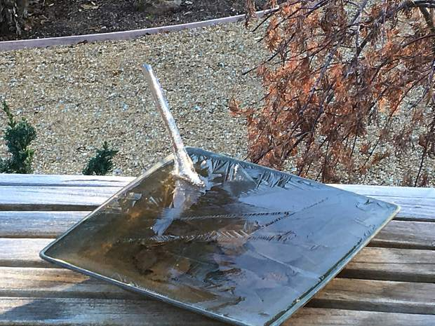 This resident woke up to this ice sculpture in the bird bath located on their deck bench after a very cold night.
