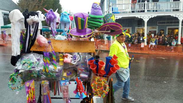 A participant in the Mardi Gras Parade strolls down Broad Street in Nevada City last weekend.