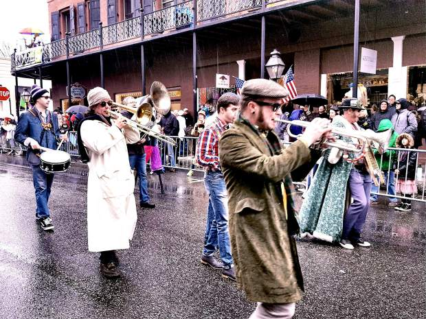 The Earles of Newtown entertain folks at the Mardi Gras parade in Nevada City on Sunday.