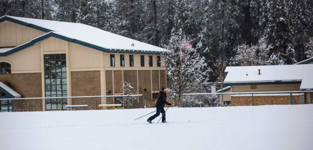 A school employee skiing to work at Union Hill School Monday. Snow day was called but some employees went to work to make sure everything is safe for kids to return.