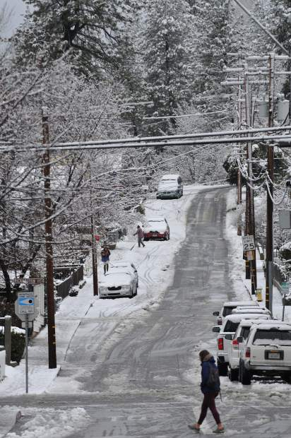With the closure of area schools and many government offices, folks took to the streets to enjoy a snow day walk along Mill Street in downtown Grass Valley.