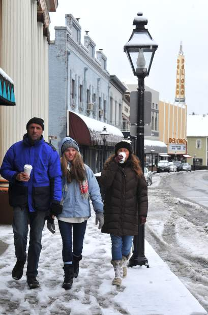 Grass Valley's Paunovic family, including Dan (from left) Lexi, and Maxi, enjoyed the snowy morning downtown while taking a stroll and sipping on coffee along Mill Street Monday morning.