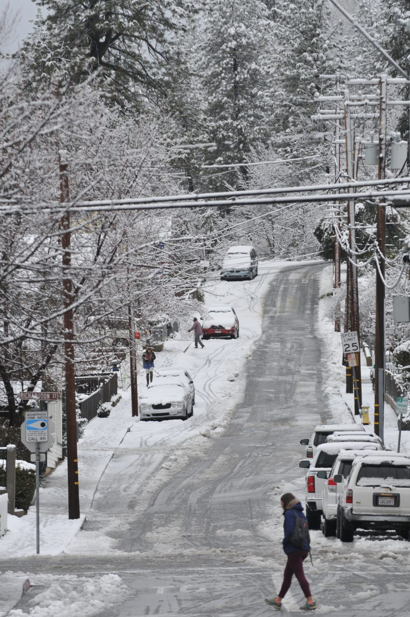 With the closure of area schools, and many government offices, folks took to the streets to enjoy a snow day walk along Mill Street in downtown Grass Valley.