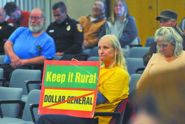 Alta Sierra's Beverly Powell holds a sign in opposition to the proposed Dollar General developments slated for Nevada County during Tuesday's Board of Supervisor's meeting on the topic.