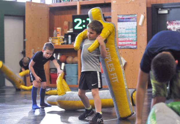 Lyman Gilmore wrestlers practice moves earlier this month.