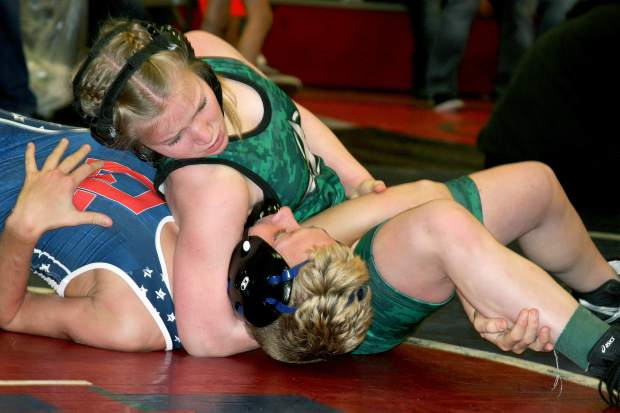 Bombers wrestler Amara Sharp, top, competes at a tournament earlier this season. Last weekend, Sharp placed first at the NorCal Regional Girls Tournament and second at the Tri-Counties (Area 3) league championship tourney.