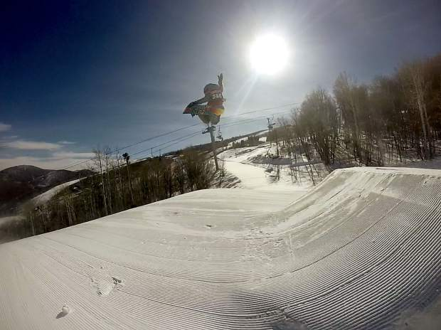Colton Bryan, 8, competes in a snowbaord slopestyle event.