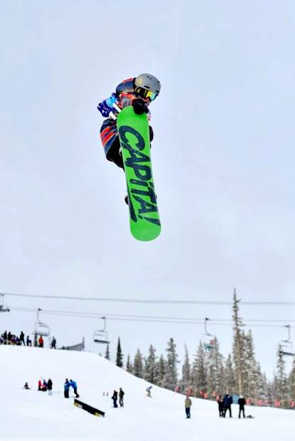10-year old Graydon Ross gets big air on his snowboard.